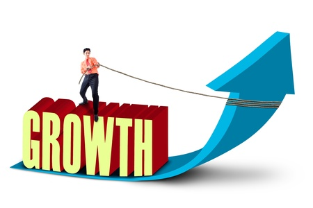 expanding: Businessman is pulling growth graph with chain on white background
