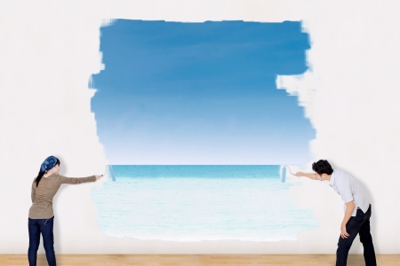 Asian couple painting beach landscape photo