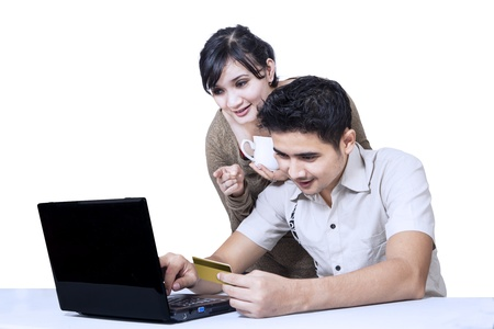 Couple pay online using credit card on white background photo