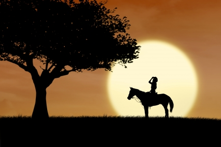 Horse rider silhouette at sunset beside the tree photo