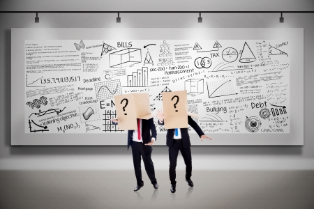 business attire teacher: Two business people with question marks boxes on written billboard background
