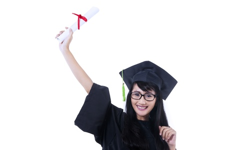Excited student wearing graduation gown on white background photo