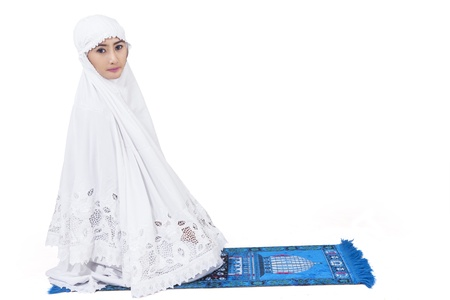 Attractive female muslim in white dress , isolated on white photo
