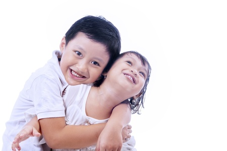 Brother expressing his love by hugging her, isolated on white photo