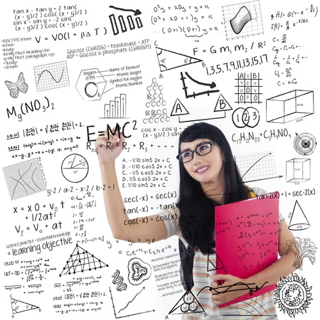 assignment: Asian female student is writing formula on whiteboard holding red folder