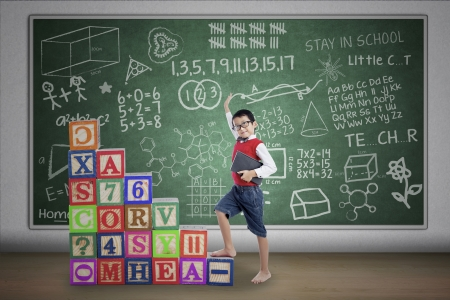 Asian student boy stepping on crossword in class Stock Photo - 20049441