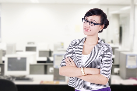 e pretty: Confident businesswoman posing at the office