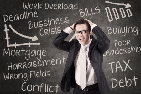 principal: Stressed businessman in front of written chalkboard