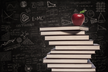 education: Education symbol of apple and stack of books in class Stock Photo