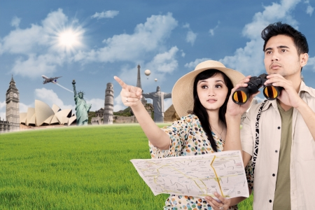 Asian couple travelling around the world with famous landmarks as background photo