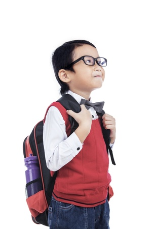 Asian nerd boy bring backpack on white background photo