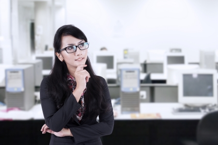 black asian: Asian Business woman with arms folded, thinking of something at the office