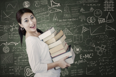 bring: Beautiful Asian woman bring stack of books in class