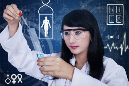 Attractive female scientist using pipette on blue background with 3D images photo