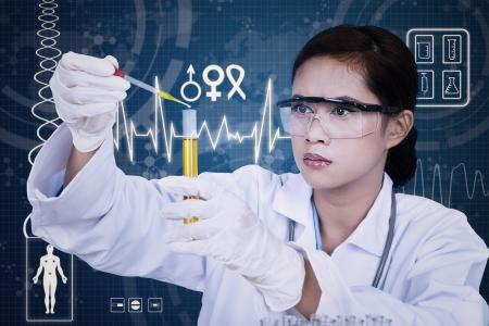female scientist: Beautiful female scientist using pipette on blue digital background