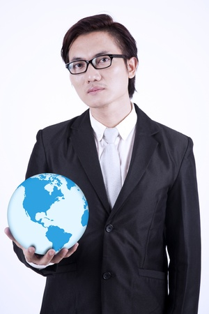 environmental suit: Confident asian businessman holding a globe, isolated on white