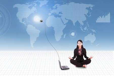 Businesswoman meditate with laptop on blue world map background Stock Photo - 20708838