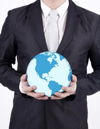 environmental suit: Businessman holding a globe on white background Stock Photo