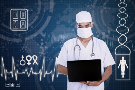 serious doctor: A medical healthcare doctor wearing a mask, stethoscope and typing on a computer laptop on blue background