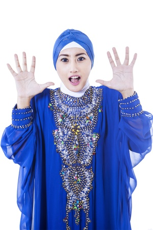 interrupt: Excited female muslim in blue dress, isolated on white