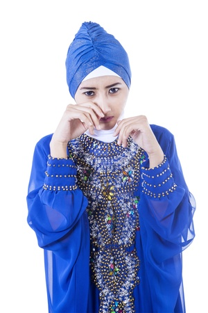 Crying female muslim in blue dress, isolated on white Stock Photo - 20708652