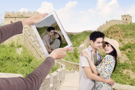Asian couple take picture at great wall of China  photo