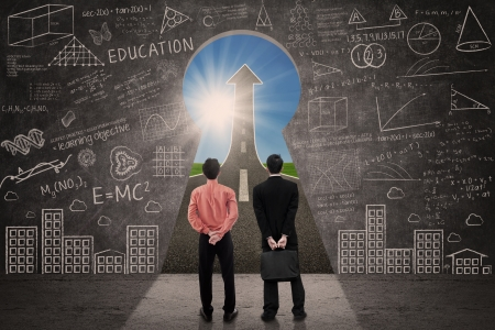 Two business people looking through keyhole an up arrow sign, inside a classroom Stock Photo - 20733464