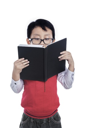 boy book: Asian boy is reading a book on white background Stock Photo