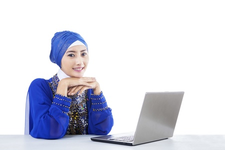 Beautiful muslim secretary with laptop - isolated on white photo