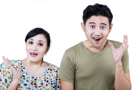 Excited Asian couple expression on white background photo