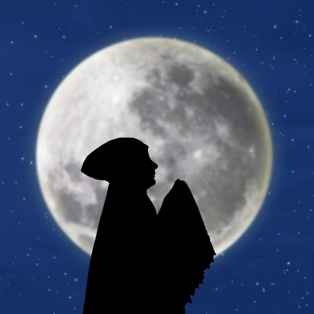 salat: Silhouette of female muslim praying under blue moon