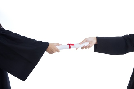 degree: Close-up of hands giving graduation certificate on white background