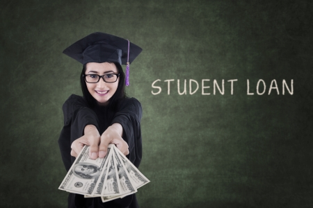 Young female graduate is getting money from student loan photo