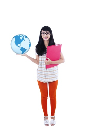 Portrait of young college student holding globe and folder photo