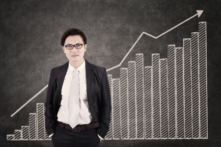 Businessman and growing bar chart in class photo