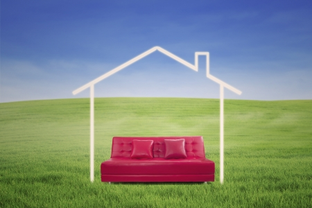 New house imagination vision with sofa on green meadow  Conceptual image photo