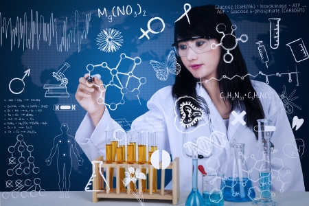 asian business woman: Attractive doctor writing formula on blue transparant background
