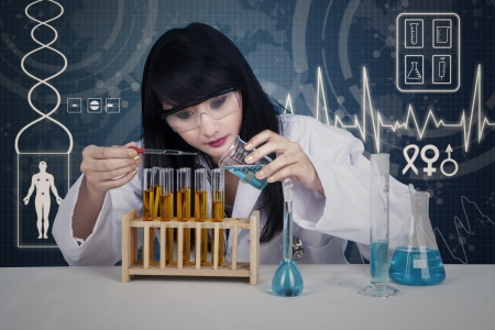 female scientist: Attractive female scientist pouring liquid inside flasks on blue digital background