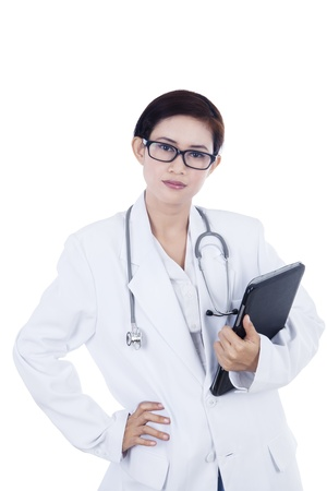 Confident female doctor and touchpad on white background photo