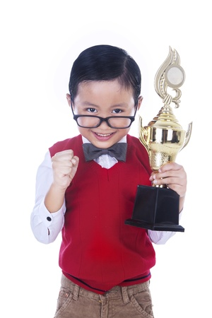 trophy winner: Handsome little boy holding tropy on white background Stock Photo
