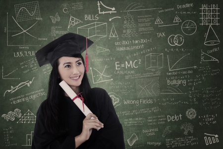 Beautiful woman graduated in class wearing graduation gown photo