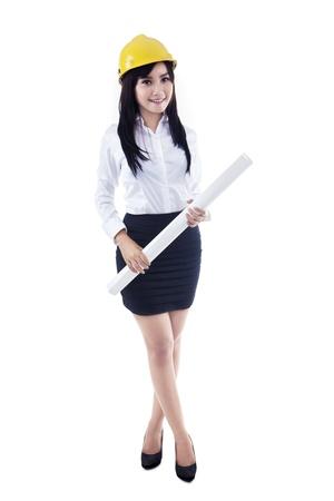 asian architect: Asian female architect with yellow helmet holding blueprint on white