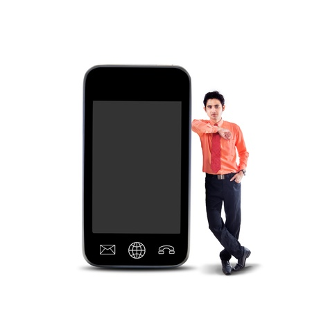 Businessman standing next to smartphone on white background Stock Photo - 21053238