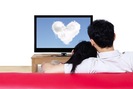 Couple watching love cloud on red sofa - isolated photo