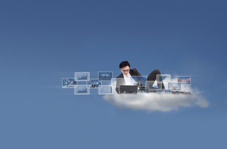 man looking at sky: Businessman working with his laptop on a cloud