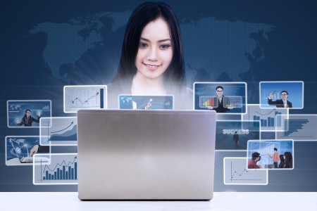 ultrabook: Businesswoman looking at online report with pictures of team on world map background Stock Photo