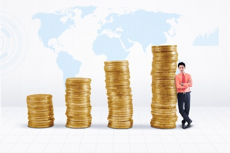 Marketing agent and rising gold coins chart on world map background
