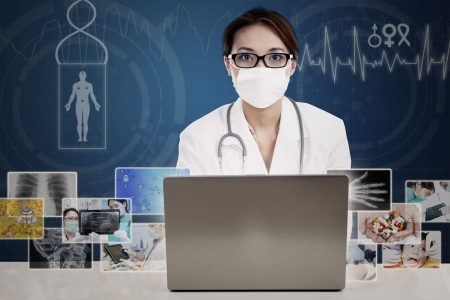 Portrait of female scientist wearing mask with laptop computer on blue digital background photo