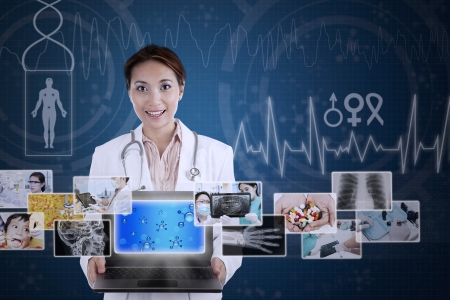 apprentice: Asian female doctor showing digital photos in her laptop on blue background