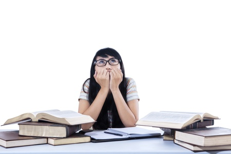 Asian female student is worry about exam on white background photo